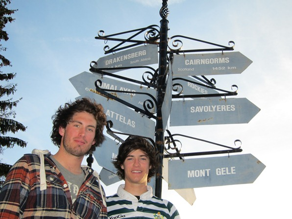 Sam Playfair and Oli Jones in front of the chalet where they work, Verbier