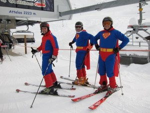 Three skiers dressed as superheroes on the slopes in Verbier
