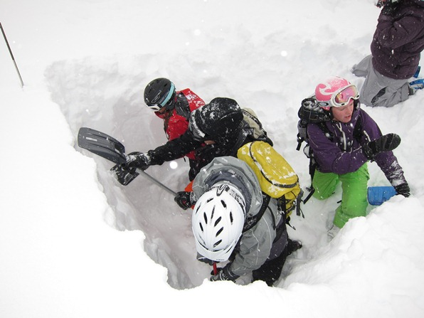 Digging a snow hole on an avalanche training course