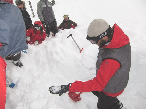 Peter Mason, mountain guide, demonstrates snow layers on an avalanche training course