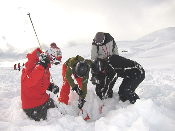 Searching for a buried transceiver on an avalanche training course, Verbier