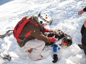 Practising accident response on the mountain on the BASI Alpine Level 1 course