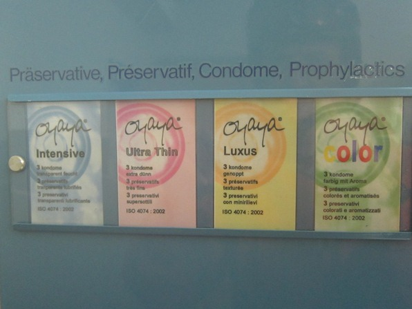 """Oyaya"" condoms for sale at a dispenser at a mountain restaurant, Verbier"