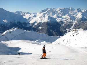 Skier on the Attelas slope, Verbier, looking towards Fontanet