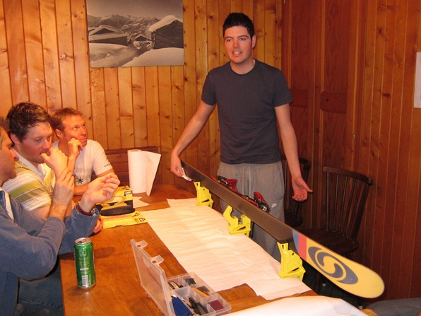 Tom Lewis, instructor with the Warren Smith Ski Academy, prepares to service a ski