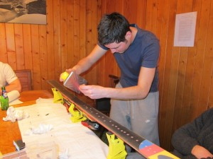 Tom Lewis, instructor with the Warren Smith Ski Academy, waxes a ski