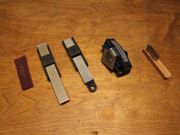 Tools for servicing skis, from left: burr rubber, fine file, coarse file, side edge file guide, cleaning brush