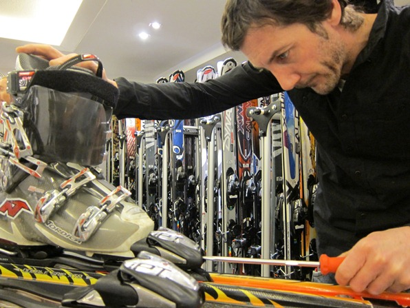 Stéphane Bouet, equipment expert at Ski Service in Verbier, adjusts a ski binding