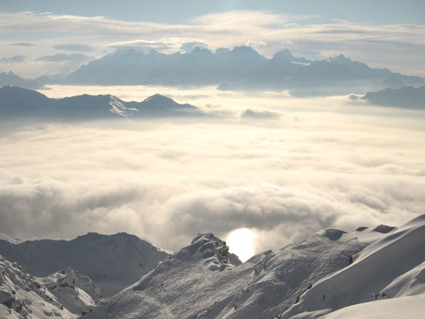 The sun reflected in the clouds, seen from Attelas, Verbier.