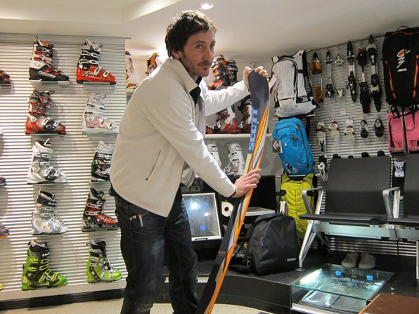 Stéphane Bouet, equipment expert at Ski Service in Verbier, examines a ski for flex