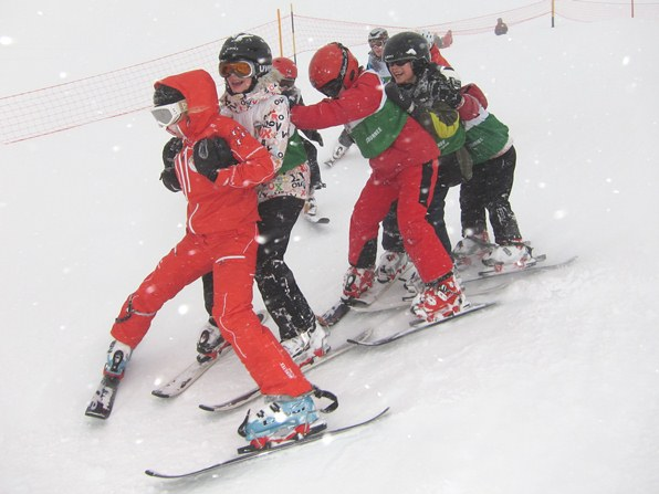 Ski instructor Chloé Darbellay leads the conga on snowblades