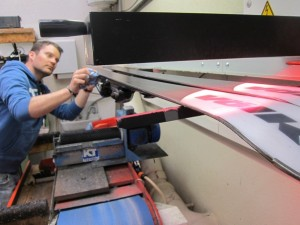 Melting the wax on the base of the skis