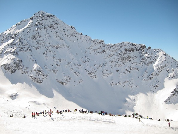 Spectators looking up at the Bec des Rosses face, Xtreme Verbier, Freeride World Tour