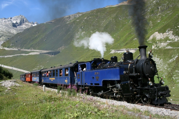 Train of the Furka Cogwheel Steam Railway climbing up to the Furka Pass