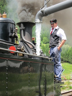 Filling the water tank of a loco of the Furka Cogwheel Steam Railway, by JB